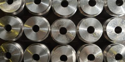 The texture of the round parts with a hole in the center at the plant for the production of valves. Close up